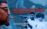 "Cover of Williams' influential book ""Negroes With Guns."""
